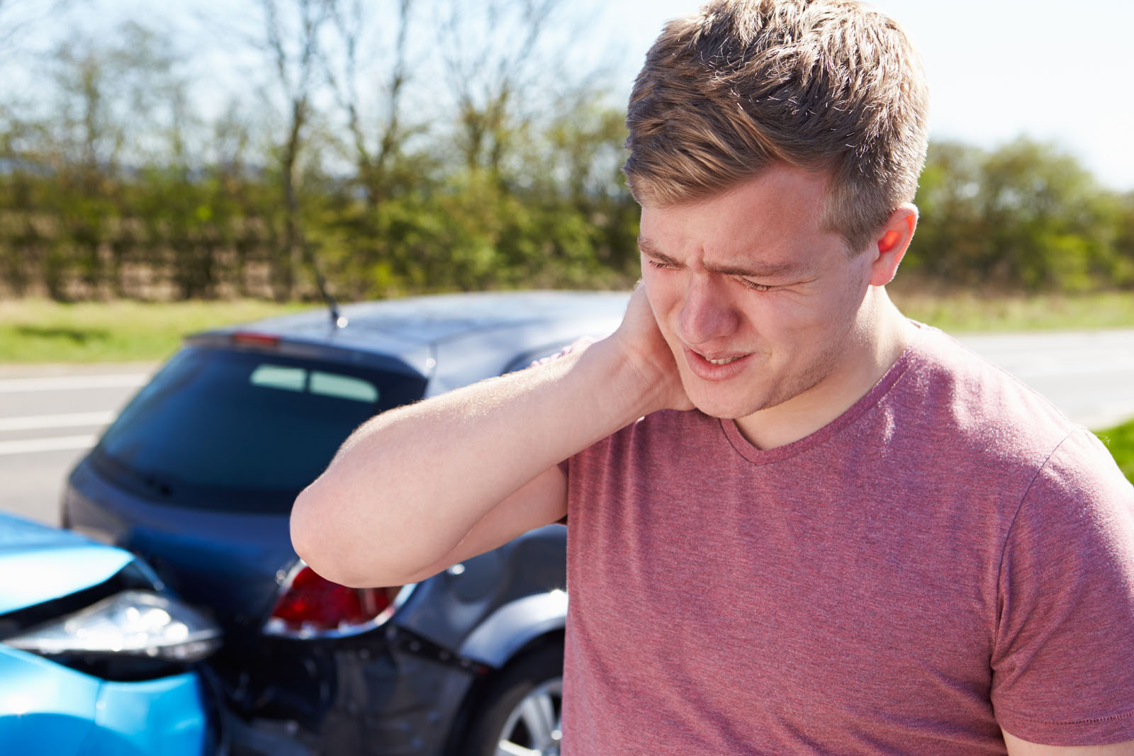 man holding neck from pain from whiplash after an auto accident
