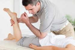 chiropractor stretching a woman Upper St. Clair