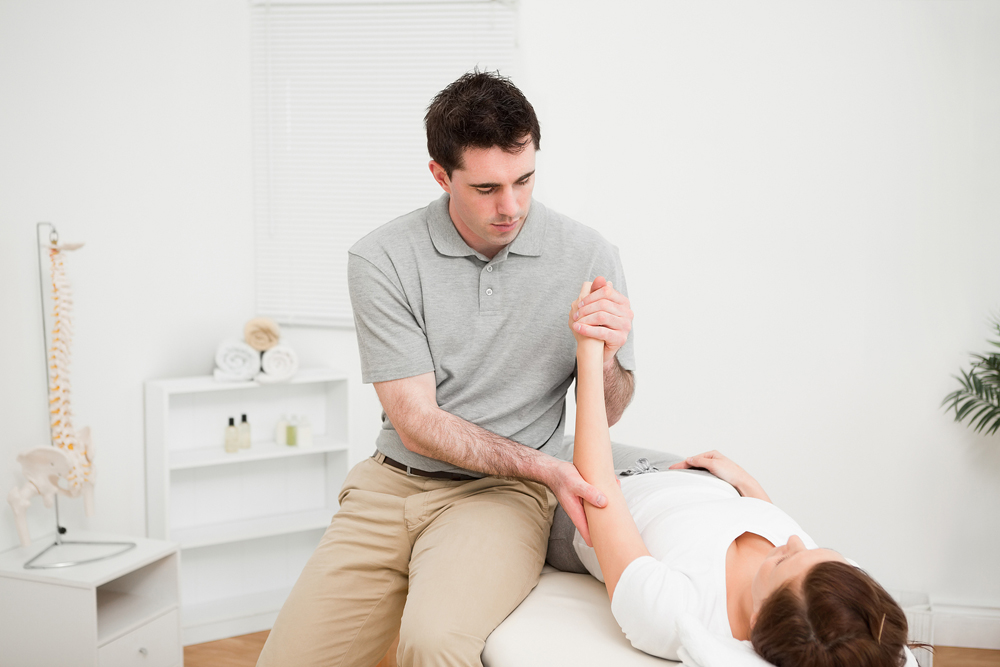 woman being examined by her chiropractor