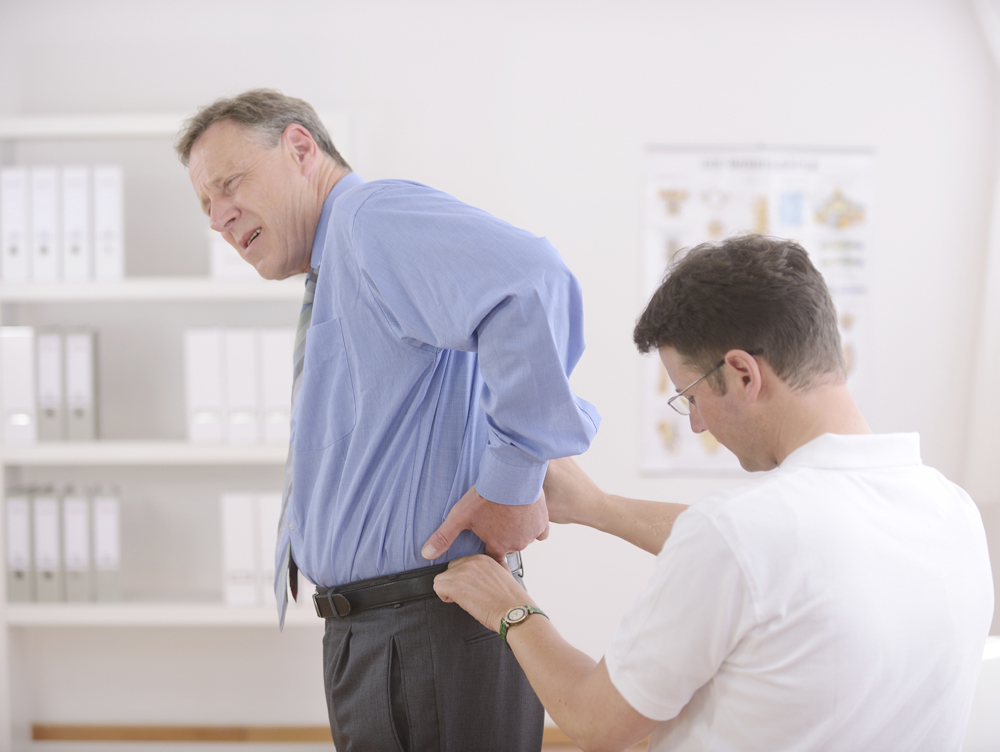 man with lower back pain is being treated by a Upper Saddle River chiropractor