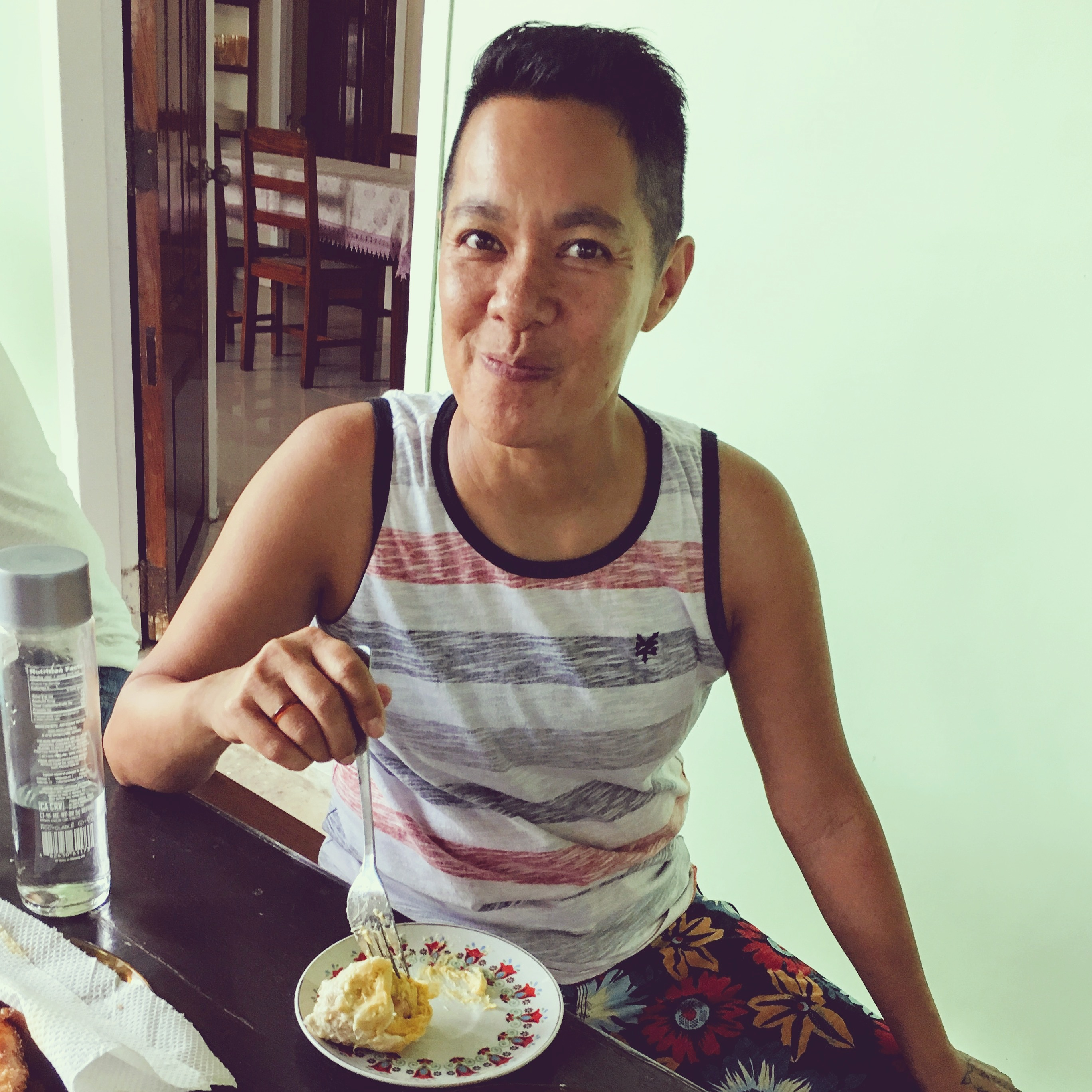Dr. Chris eating durian