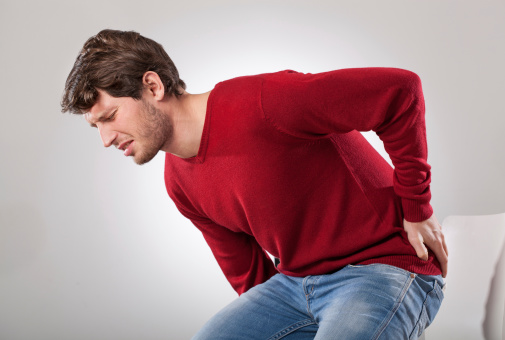 Man with back pain in Sugar Land TX