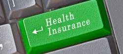 image of computer keyboard button, click to be directed to the health insurance information page.