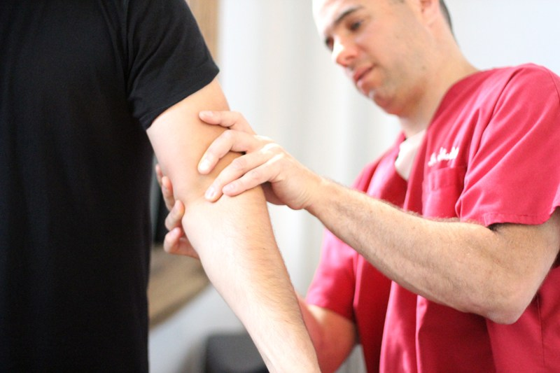 Dr Shoshany, a chiropractor in NYC, perform an Active Release Techinique on a patient suffering from tennis elbow