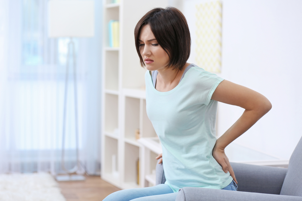 Woman with low back pain in Broomfield