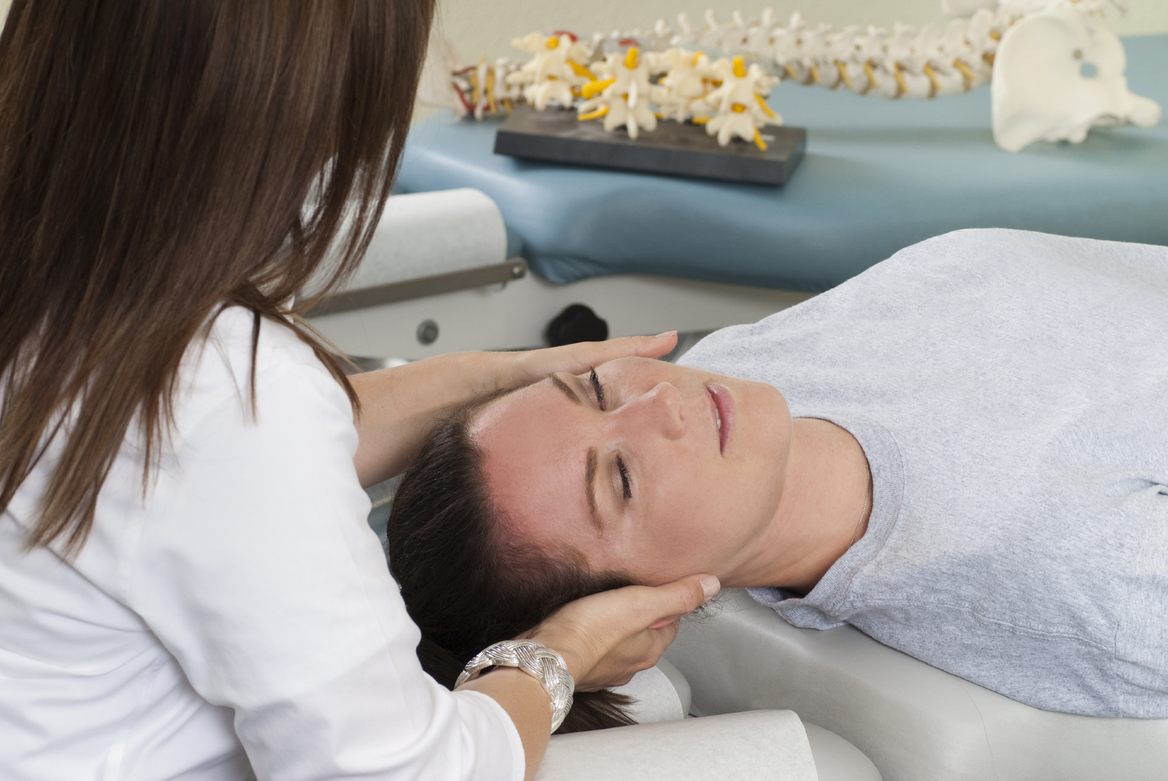woman getting chiropractic adjustment in Dallas, TX