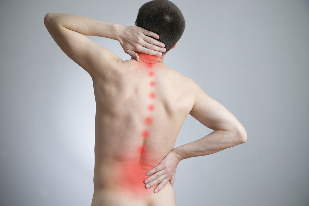 A man holding his bag along with a graphic to indicate pain down his spine