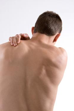 man_holding_shoulder_in_pain