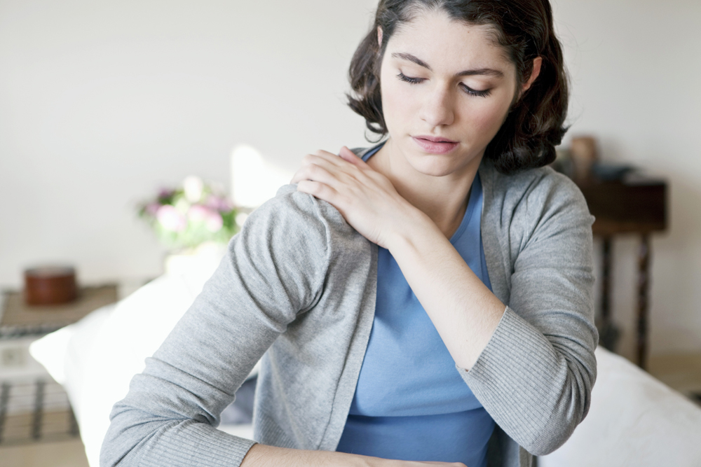 woman with stress and shoulder and neck pain.