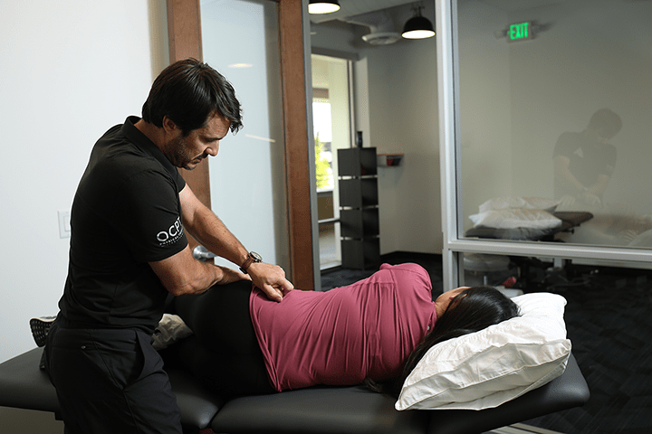 Dr. victor providing physical therapy to client on table